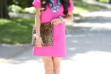 With leopard clutch, black sandals and turquoise necklace