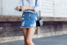 With light blue shirt, denim skirt and black mini bag