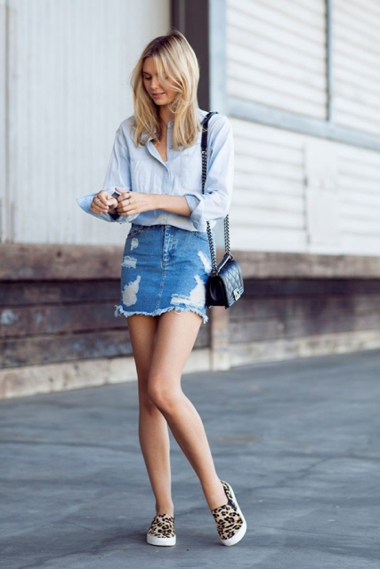 With light blue shirt, denim skirt and black mini bag