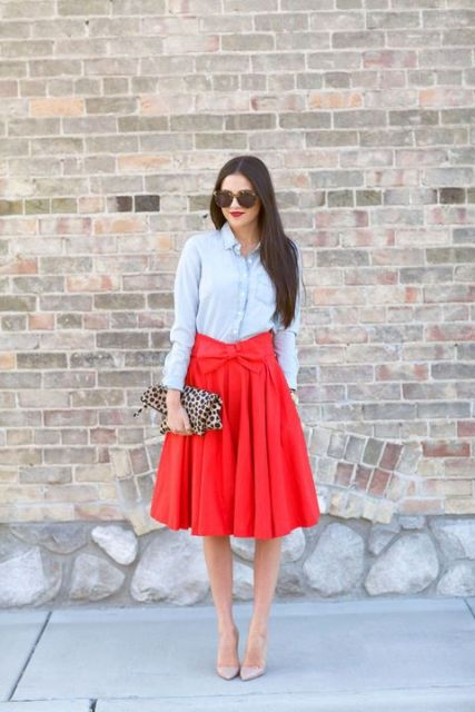 With light blue shirt, leopard clutch and beige pumps
