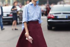 With light blue shirt, pale pink heels and clutch