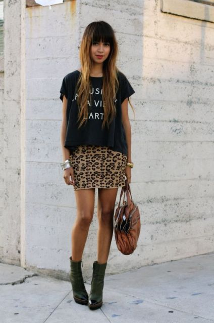 With loose black t-shirt, brown bag and ankle boots