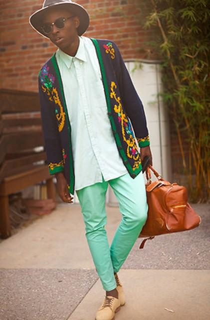 With loose shirt, printed cardigan, hat and brown bag