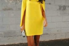 With metallic shoes and small clutch