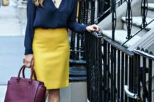 With navy blue blouse, beige heels and purple bag