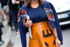 With navy blue top, printed crop jacket and mini bag