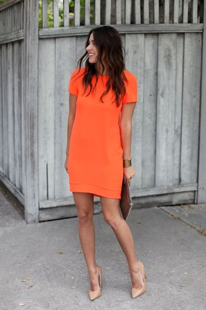 With neutral color pumps and clutch