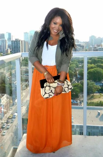 With olive green jacket, white shirt and printed clutch