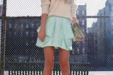 With oversized sweater, two color shoes, hat and printed clutch