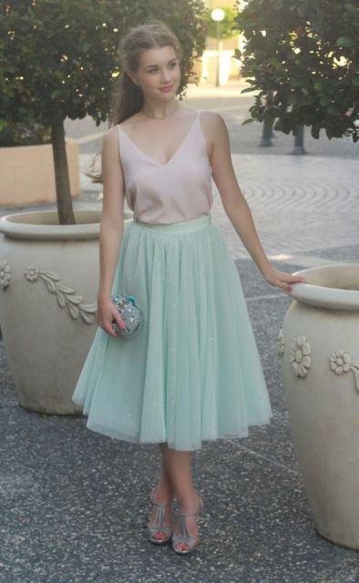 With pale pink silk top, silver shoes and mini clutch