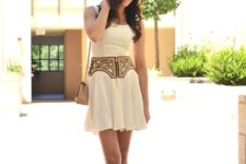 With pastel color dress and beige shoes