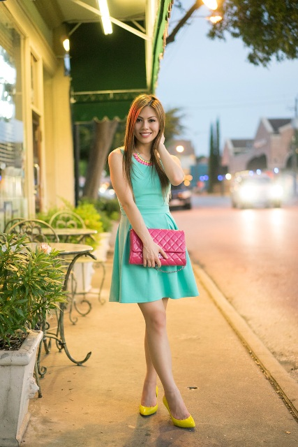 With pink clutch and yellow shoes