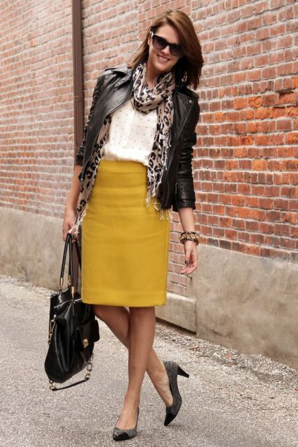 With polka dot blouse, leather jacket, printed scarf, gray shoes and bag