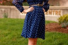 With polka dot dress and belt