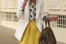 With polka dot shirt, white blazer and big bag