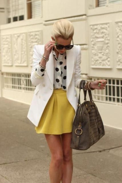 With polka dot shirt, white blazer and big bag