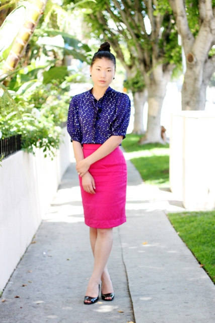 With printed blouse and simple black shoes