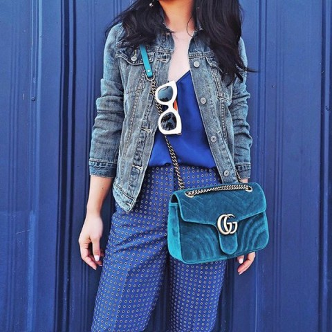 With printed pants, blue silk top and denim jacket