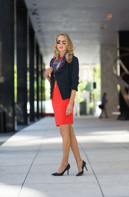 With printed scarf, black blazer and black pumps
