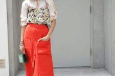 With printed shirt, metallic shoes and mini bag