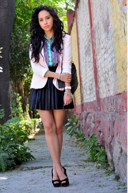 With printed shirt, pleated skirt and black shoes