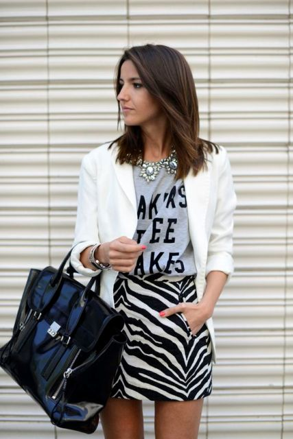 With printed shirt, white blazer and big leather bag