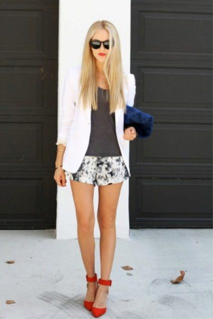 With printed shorts, gray top, white blazer and red heels