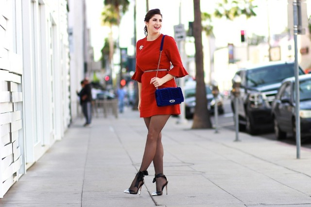With red dress and black heels