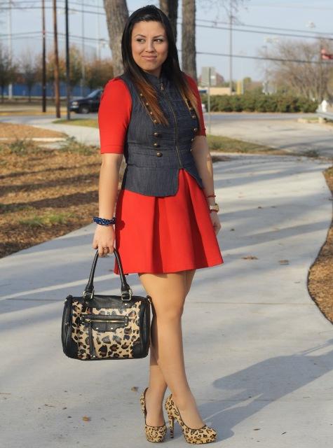 With red dress, denim vest and leopard bag