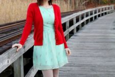 With red jacket and red flats