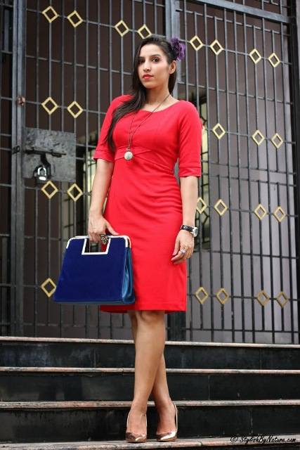 With red knee-length dress and metallic shoes