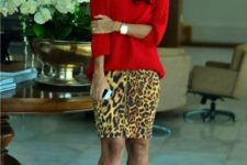 With red loose sweater and black sandals