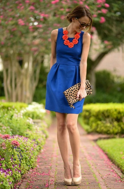 With red necklace, leopard clutch and platform shoes