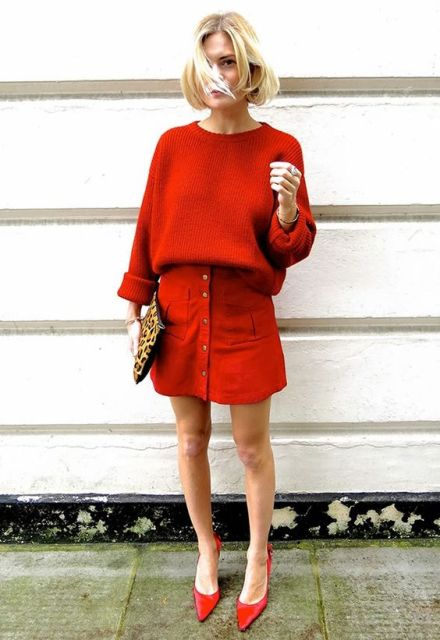 Eye-catchy spring office outfit with red oversized sweater, leopard clutch and red shoes
