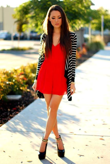 With striped cardigan and black platform shoes