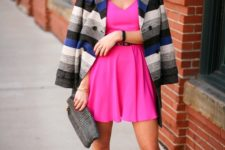 With striped jacket, silver shoes and printed clutch
