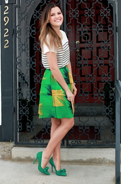 With striped shirt and green and yellow skirt
