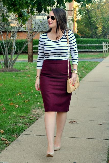 With striped shirt, beige small bag and nude pumps