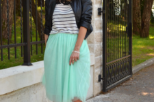 With striped shirt, black leather jacket and black shoes