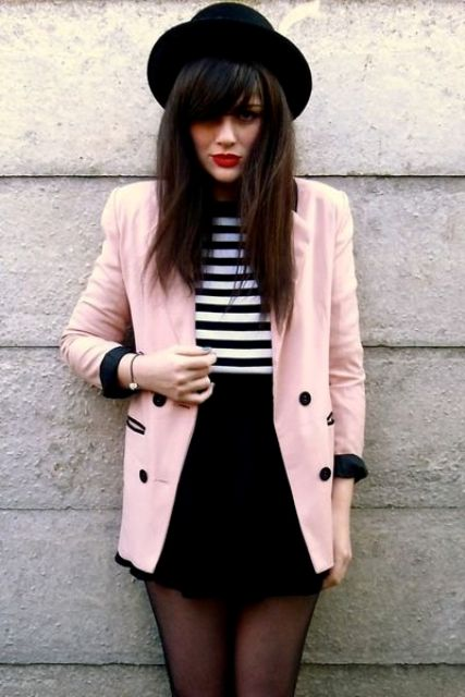 With striped shirt, black mini skirt and black hat