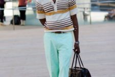 With striped shirt, brown shoes, hat and black big bag