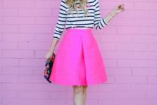 With striped shirt, pink shoes and printed clutch