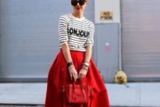 With striped shirt, red shoes and red bag