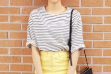 With striped shirt, sunglasses and black leather bag