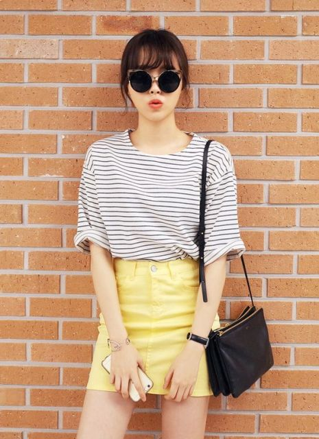 Picture Of With Striped Shirt Sunglasses And Black Leather Bag