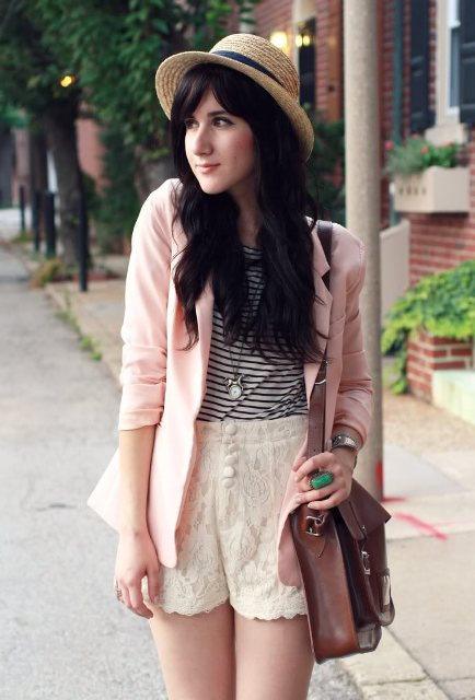 With striped shirt, white shorts, brown bag and straw hat