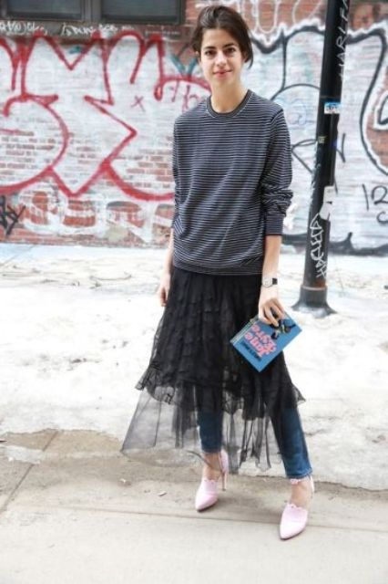 With striped sweatshirt, jeans and pastel color shoes