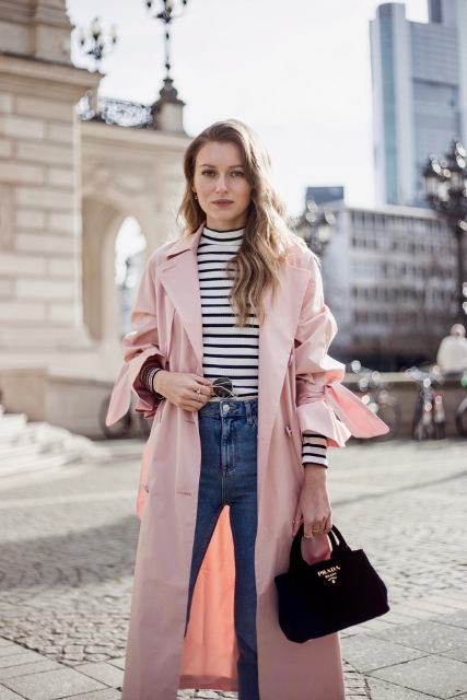 With striped turtleneck, jeans and pale pink trench coat