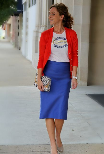 With t-shirt, red blazer and printed clutch