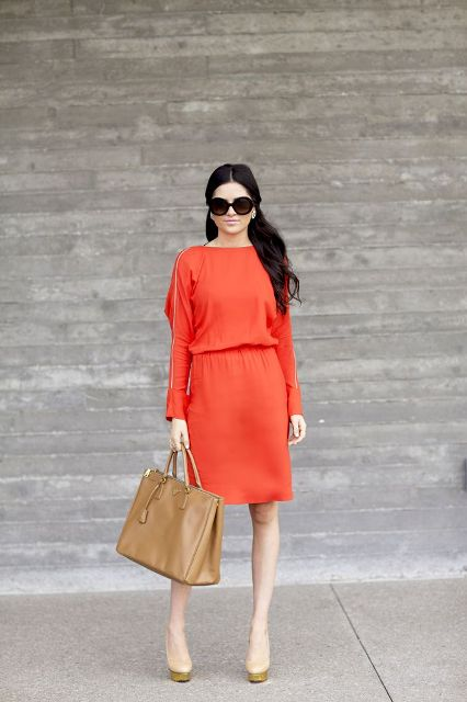 With two color shoes and camel bag